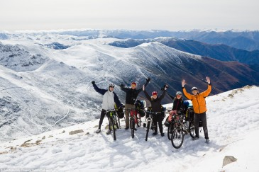 Cyclists at snowy pass in Pontic Mountains, Turkey