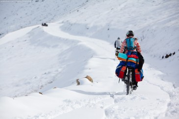 Cyclist on snowy road in Kachkar Mountains. Turkey
