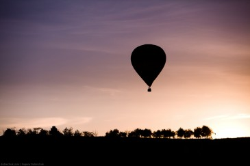 Silhouette of balloon at sunrise flying in Cappadocia