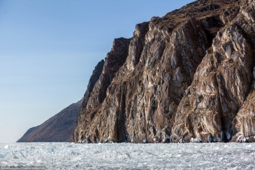 Steep shore of frozen lake Baikal