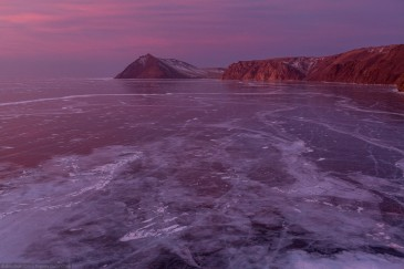 Frozen lake Baikal in winter at sunrise