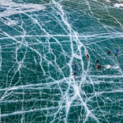 Поход по Байкалу на коньках. Вид на лед с высоты птичьего полета. Baikal lake ice skates tour. Top view