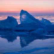 Ледяные торосы на Байкале на рассвете. Поход по Байкалу на коньках. Ice hummock on Baikal lake at sunrise. Ice skating tour.