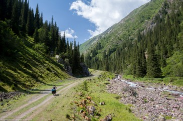 Cyclist on abandoned road in Tien Shan Mountains