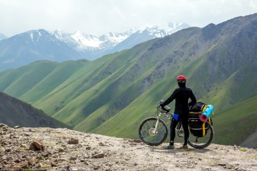 Cyclist in Tien Shan Mountains. Kyrgyzstan