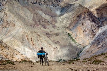 Cyclist on path of Zanskar Valley. India