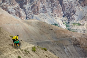 Cycling tourist on narrow path. Zanskar, Himalaya mountains
