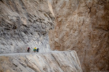 Touring cyclists on dangerous mountain road. Ladakh, Indian Himalayas