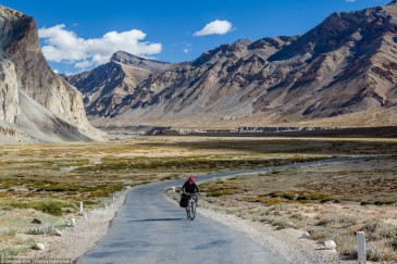 Tourist cycling in Himalayas. India