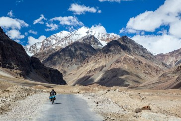 Cyclist on mountain road in Himalayas. Ladakh, India