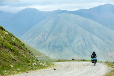 Cyclist in wonderful Tien Shan Mountains