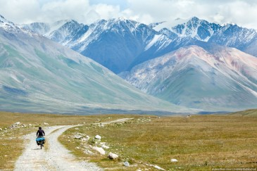Travelling cyclist in Tien Shan Mountains. Kirghizia