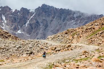 Cyclist at mountain pass. Tien Shan, Kirghizia