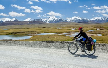 Girl cycling in Tien Shan Mountains