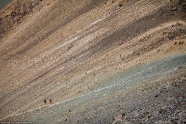 Hikers going to the pass by trail in Tien Shan Mountains. Kyrgyzstan