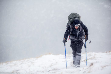 Hiker in severe weather conditions. Altai mountains