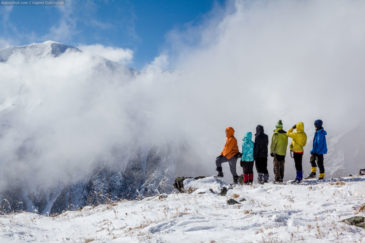 On the top of the pass. Group of hikers in Altai mountains