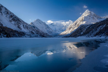 Freezing Akkem lake and Belukha mountain in the morning. Altai