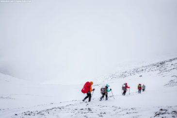 Hikers going from the pass. Altai