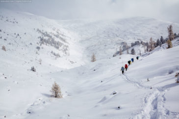 Snow-covered mountains of Altai republic and hikers