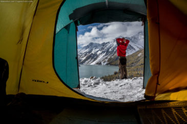 View at Kucherla lake and hiker from inside of tent. Altai mountains