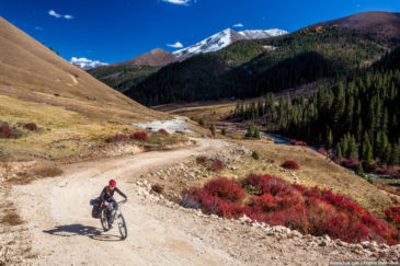 Adventurer cycling in Tibet mountains
